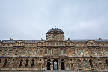 Courtyard of Louvre Palace (Palais du Louvre) in Paris, France, taken during a cloudy afternoon. This former royal palace is now one of the biggest art museums in the world