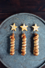 Three fireworks-themed hotdogs