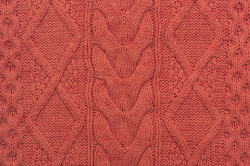 Knitted background. Knitted pink texture. Knitting pattern of wool. Knitting. Background.