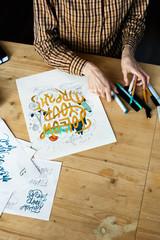 Designer finishing creative sketch