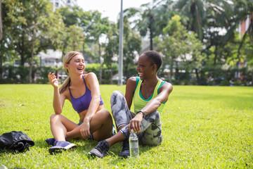 Two girlfriends talking after a run