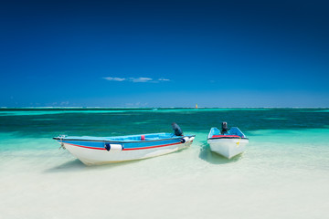 Carribean sea and speed boat for trip adventure on the beach