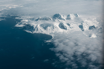 snow covered summits at an arctic coastline
