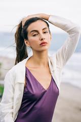 Outdoor Portrait of Pretty Caucasian Female Model in Purple Swimsuit
