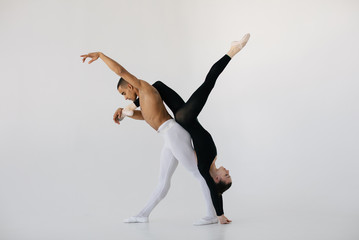 Man holding ballerina upside down