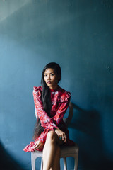 Portrait of asian woman in red dress