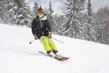 Portrait of male skier smiling while freeriding off piste