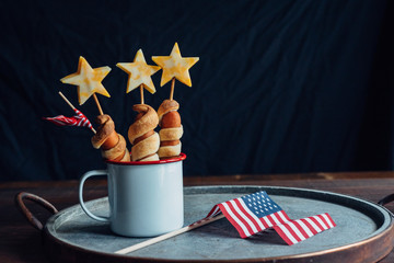 Star-shaped hotdogs and american flag