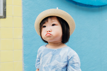Asian little girl with straw hat