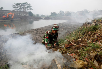 The Wider Image: Indonesia aims to banish toxic waste from lifeline river