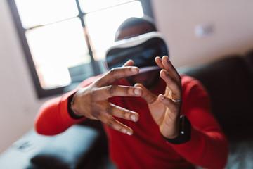 Man wearing VR glasses indoors