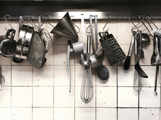 Kitchen Utensils hanging on the rack