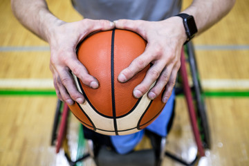 Close up Shot of Disabled Athlete Hands Holding a Basketball