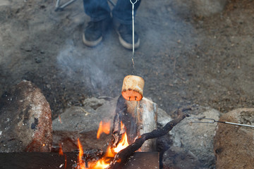 Roasting a marshmallow over an open flame
