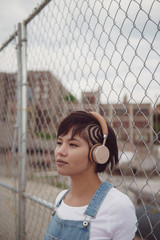 Girl with overalls listening to music