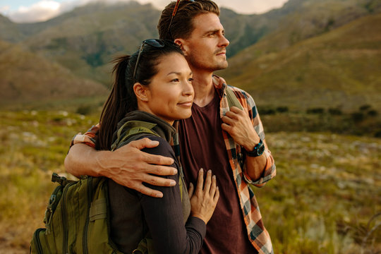 Loving young couple on hiking trip in nature