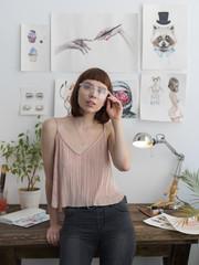 Woman looking at camera at workplace