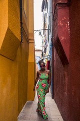 Woman visiting Burano, Venice, Italy.
