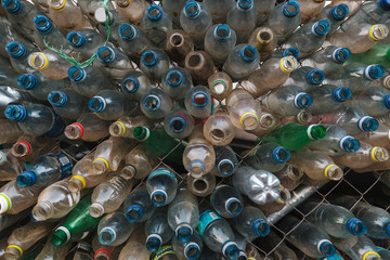 Bottles in fence