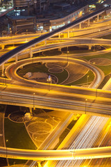 aerial view of busy traffic on sheikh zayed road intersection at night, Dubai - futuristic city