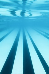 under water perspective of swimming pool lanes