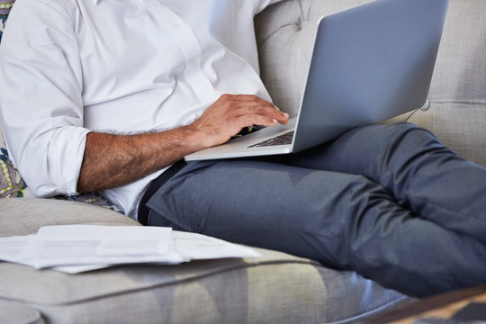 Hispanic business man working at home in living room