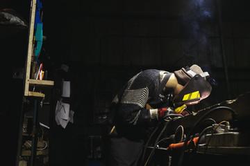 Man working on a custom-made motorbike