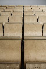 Desks in an empty lecture hall