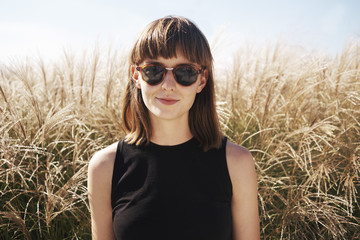 Portrait of a young attractive woman wearing sunglasses