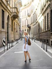 Girl walking on old street