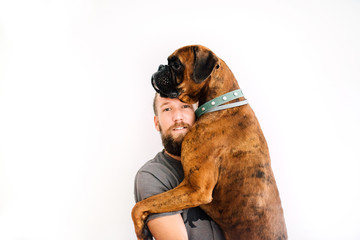 Man hugging with brown Boxer dog