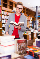 man searching for information in books