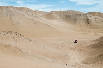 4x4 vehicle in a desert ready to go up in sand dunes