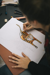 Designer working in her studio.