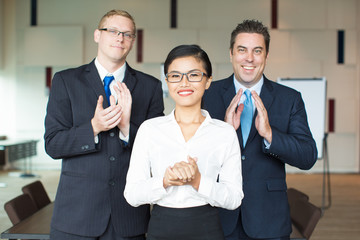 Successful female leader and her male executives