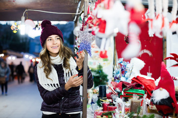 Portrait of  young woman buying Christmas decoration
