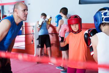 Children training on boxing ring