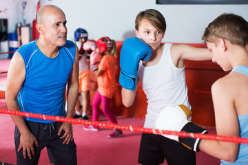 Children training on boxing ring