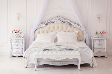 bright, cozy stylish interior bedroom beautiful rich antique furniture four-poster bed with canopy