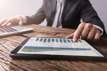 Businessman Working With Graph On Digital Tablet