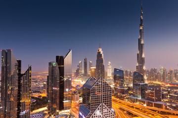 DUBAI, UAE - FEBRUARY 2018: Dubai skyline at sunset with Burj Khalifa, the world tallest building and Sheikh Zayed road traffic