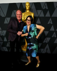 "McGrath and Naito, nominees for ""The Boss Baby,"" pose at the reception for the 2017 Oscar-nominated films in Beverly Hills"