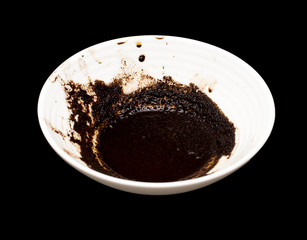 A cup of coffee on a black background