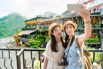 girls taking selfie of famous landmarks