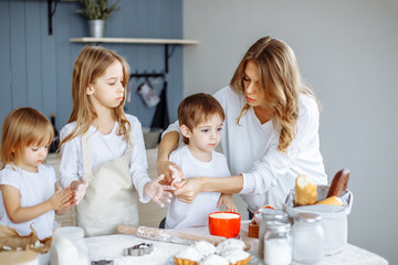 Homemade cooking. Happy family makes cakes together in the kitchen