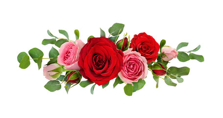 Red and pink rose flowers with eucalyptus leaves in a line arrangement