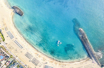 Aluminium Prints Canary Islands Aerial view of Los Cristianos bay beach in Tenerife with sunbeds and umbrellas miniature - Travel concept with nature wonder landscape in Canary islands Spain - Bright warm day filter