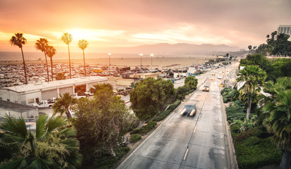 Aerial panoramic view of Ocean Ave freeway in Santa Monica beach at sunset - City streets of Los Angeles and California state surrounds - Warm twilight color filter tones with dark vignetting Wall mural