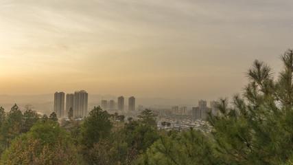 Foggy city under the sun