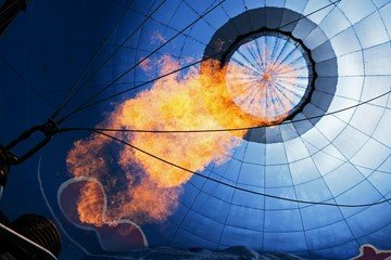 Hot air balloon being heated with a flame, Montgolfiade Bad Wiessee, Tegernsee, Bavaria, Germany, Europe